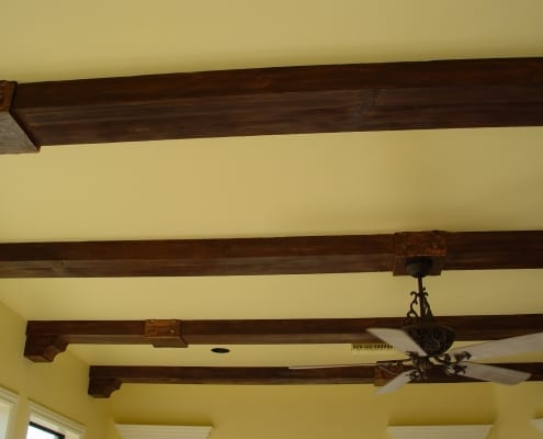 Faux wood beams design